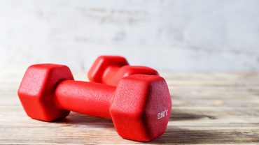Free weights laying on the ground
